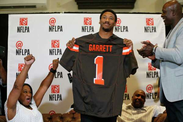 """Myles Garrett chose to watch the draft from his home in Arlington surrounded by friends and family. """"I won't let them down,"""" the defensive end said about the crowd."""