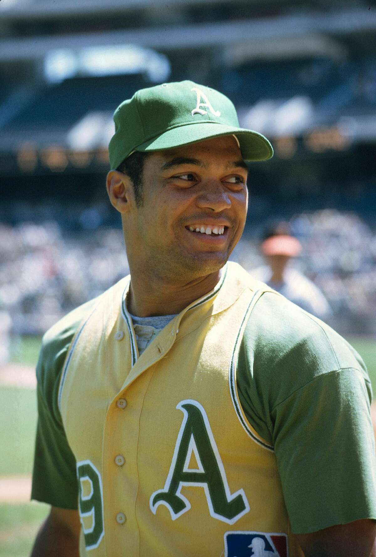 OAKLAND, CA - CIRCA 1969: Reggie Jackson #9 of the Oakland Athletics looks on smiling prior to the start of a Major League Baseball game circa 1969 at Oakland-Alameda County Coliseum in Oakland, California. Jackson played for the Athletics from 1967-75, 8