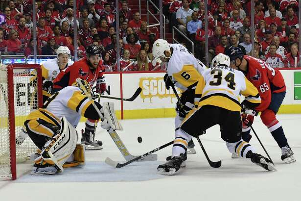 Capitals right wing Tom Wilson, left, tries to shoot the puck past Penguins teammates Trevor Daley (6) and Tom Kuhnhackl (34) during the first period of Game 1 on Thursday night in Washington, D.C. Pittsburgh goalie Marc-Andre Fleury had 33 saves as the Penguins took Game 1, 3-2. Must credit: Washington Post photo by Ricky Carioti