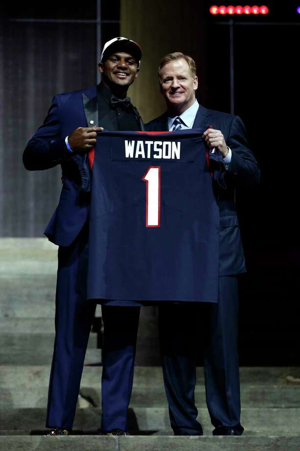 Deshaun Watson joins NFL commissioner Roger Goodell after being selected with the No. 12  pick when the Texans swapped first-round places with the Browns and sent a 2018 first-rounder to Cleveland. Photo: Matt Rourke, STF / Copyright 2017 The Associated Press. All rights reserved.