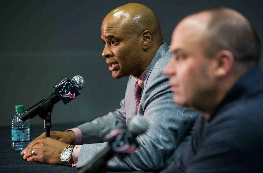 Texans general manager Rick Smith, left, and coach Bill O'Brien discuss the team's selection of quarterback Deshaun Watson, a move they made after agreeing to send a 2018 first-round draft choice to the Browns.Click through the gallery to see photos from the Texans' draft party. Photo: Brett Coomer, Staff / © 2017 Houston Chronicle