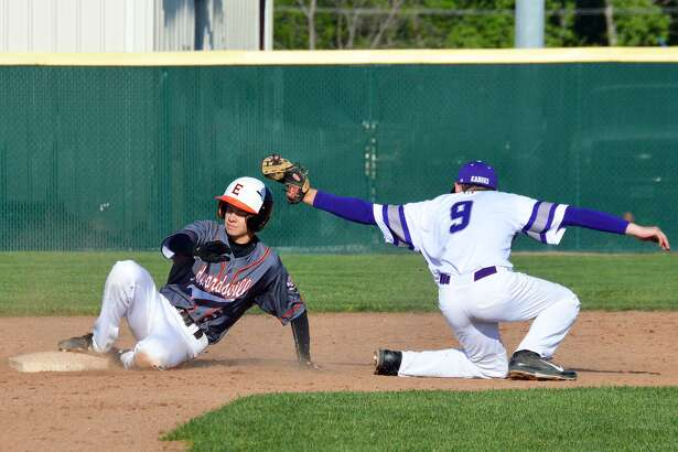 Edwardsville's Blake Burris, left, avoids the tag and slides safely into second base during Thursday's Southwestern Conference game against the Collinsville Kahoks at Tom Pile Field.