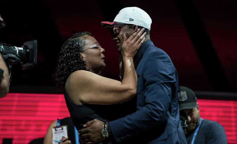 Deshaun Watson shares his draft moment with his mother Deann, a cancer survivor, in Philadelphia. Photo: BEN SOLOMON, STR / NYTNS