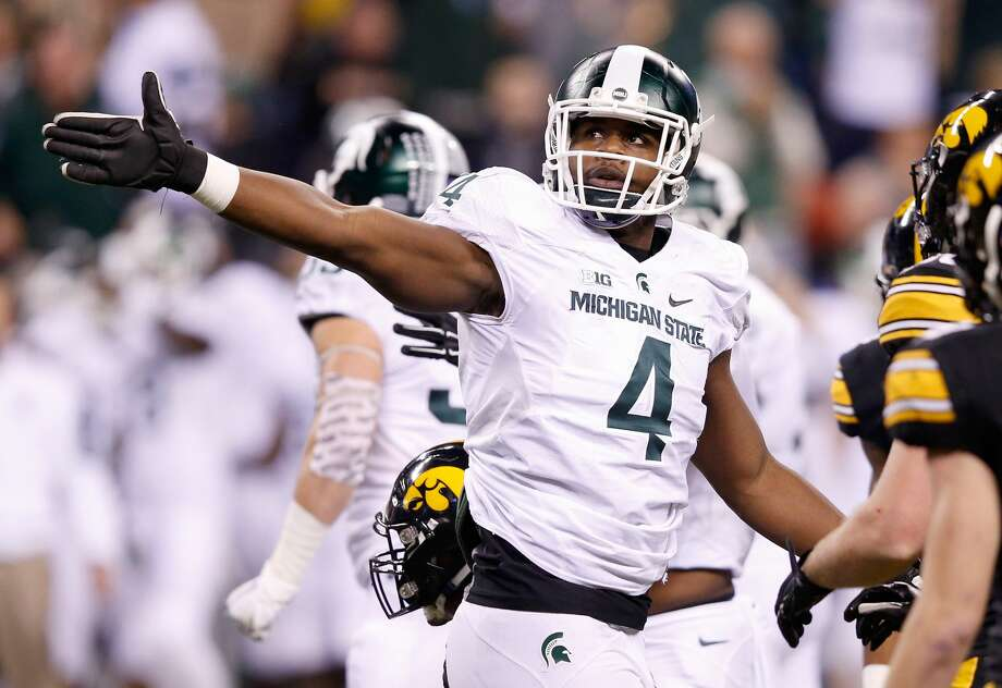 Malik McDowell of the Michigan State Spartans reacts during the game against the Iowa Hawkeyes in the Big Ten Championship at Lucas Oil Stadium on December 5, 2015 in Indianapolis, Indiana.  (Photo by Joe Robbins/Getty Images) Photo: Joe Robbins/Getty Images