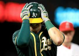 ANAHEIM, CA - APRIL 27:  Ryon Healy #25 of the Oakland Athletics reacts to flying out with a runner on base during the ninth inning of a game against the Los Angeles Angels of Anaheim at Angel Stadium of Anaheim on April 27, 2017 in Anaheim, California.  (Photo by Sean M. Haffey/Getty Images)