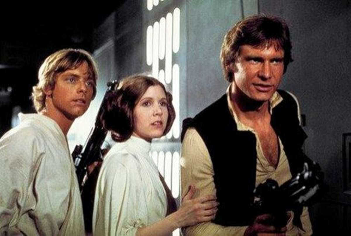 This photo provided by Twentieth Century Fox Home Entertainment shows, Mark Hamill, from left, as Luke Skywalker, Carrie Fisher as Princess Leia Organa, and Harrison Ford as Hans Solo in the original 1977
