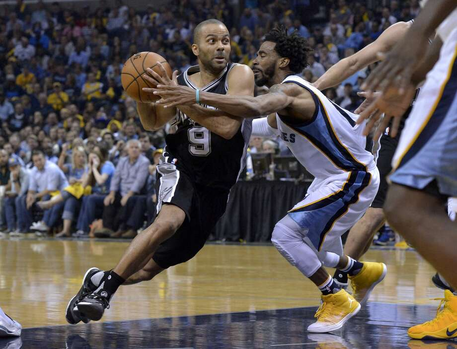 San Antonio Spurs guard Tony Parker (9) drives against Memphis Grizzlies guard Mike Conley during the second half of Game 6 in an NBA basketball first-round playoff series Thursday, April 27, 2017, in Memphis, Tenn. (AP Photo/Brandon Dill) Photo: Brandon Dill/Associated Press