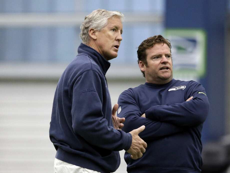 Seattle Seahawks head coach Pete Carroll, left, and general manager John Schneider talk during an NFL football rookie minicamp workout Sunday, May 8, 2016, in Renton, Wash. (AP Photo/Elaine Thompson) Photo: Elaine Thompson/AP