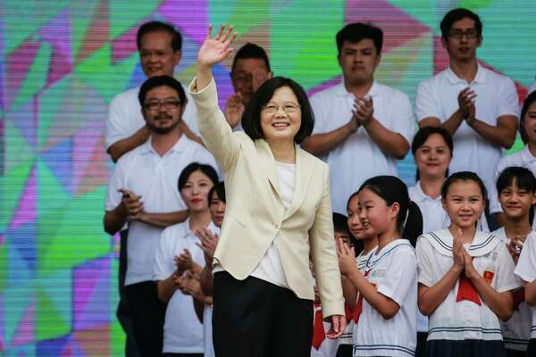 Taiwan President Tsai Ing-wen waves during her inauguration ceremony at the Presidential Palace in Taipei, Taiwan, on May 20, 2016.