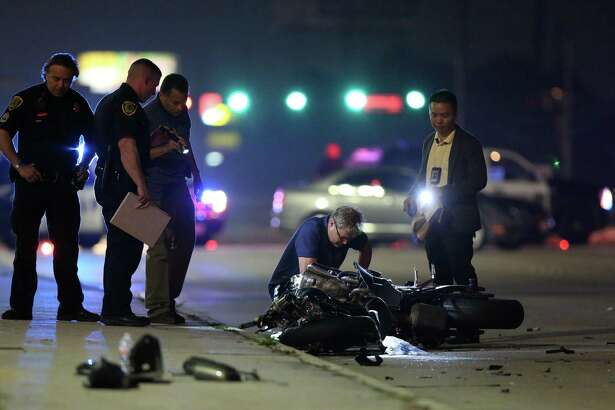 Authorities investigate the scene of a motorcycle and vehicle crash on Westheimer Road near Eldridge Parkway Friday, April 28, 2017, in Houston. The man driving the motorcycle died.