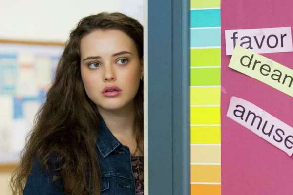 "This image released by Netflix shows Katherine Langford in a scene from the series, ""13 Reasons Why,"" about a teenager who commits suicide. The stomach-turning suicide scene has triggered criticism from some mental health advocates that it romanticizes suicide and even promoted many schools across the country to send warning letters to parents and guardians. The show's creators are unapologetic, saying their frank depiction of teen life needs to be ""unflinching and raw."" (Beth Dubber/Netflix via AP)"