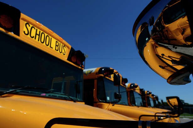 Beaumont ISD has 30 of the 97 planned new school buses at their transportation center on Thursday afternoon. The district's new buses all have air conditioning, seat belts and camera systems.  Photo taken Thursday 4/27/17 Ryan Pelham/The Enterprise