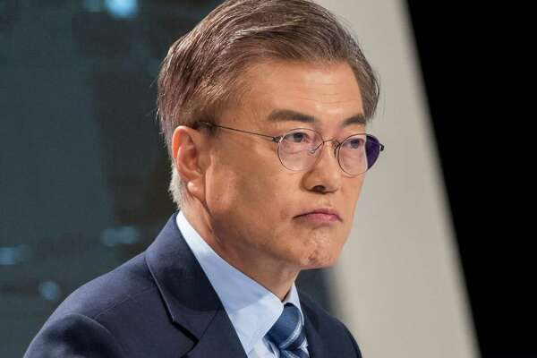 Moon Jae-in, presidential candidate of the Democratic Party of Korea, attends a televised presidential debate in Seoul on Friday.