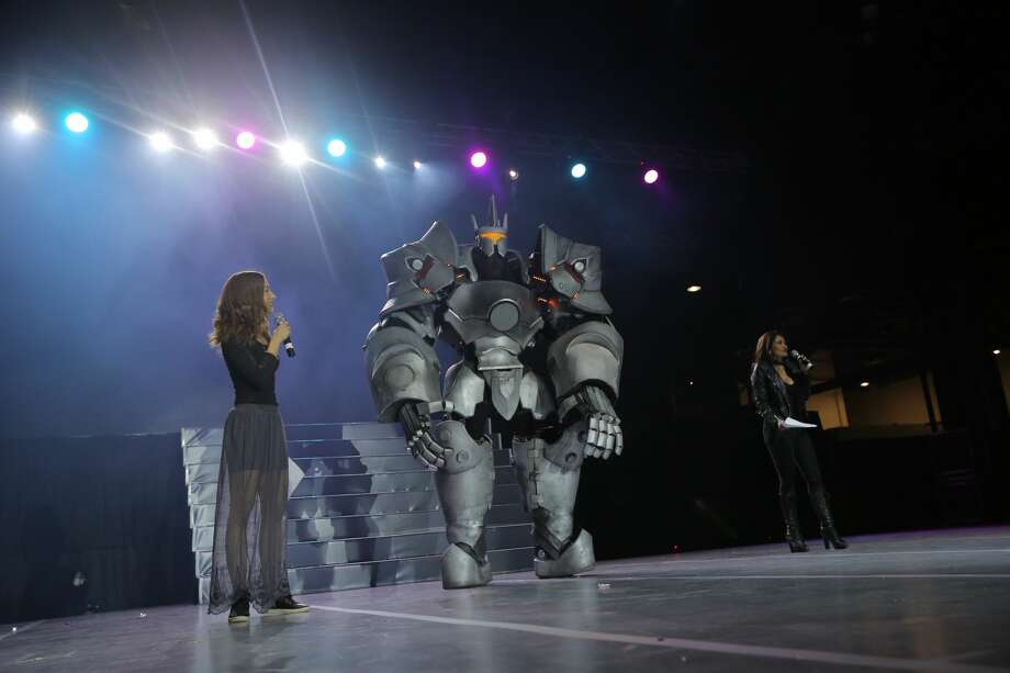 """Cosplayers pose on stage during the Anime Matsuri Cosplay Contest at George R. Brown Convention Center in Houston, Texas on April 8, 2017. Anjali Bhimani and Carolina Ravassa, voice actors of the popular game """"Overwatch"""" were emcees at the event. Photo: Luxe Studio Productions/Houston Chronicle Via Anime Matsuri Convention"""