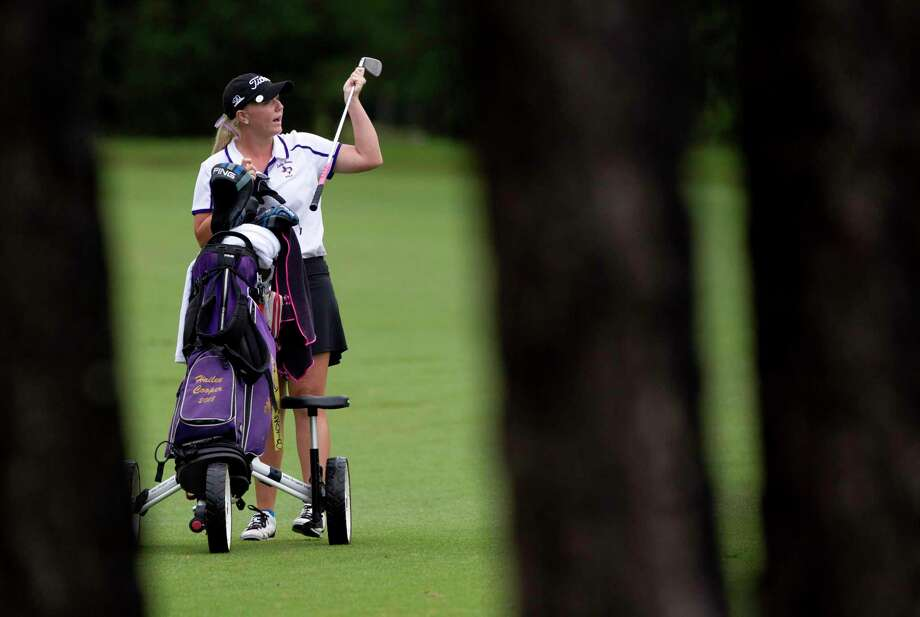 Hailee Cooper of Montgomery pulls a club out of her bag on the seventh hole during the final round of the District 12-6A girls golf tournament at High Meadow Ranch, Tuesday, April 11, 2017, in Magnolia. Cooper shot four under par to take first place overall in the tournament. Photo: Jason Fochtman, Staff Photographer / © 2017 Houston Chronicle