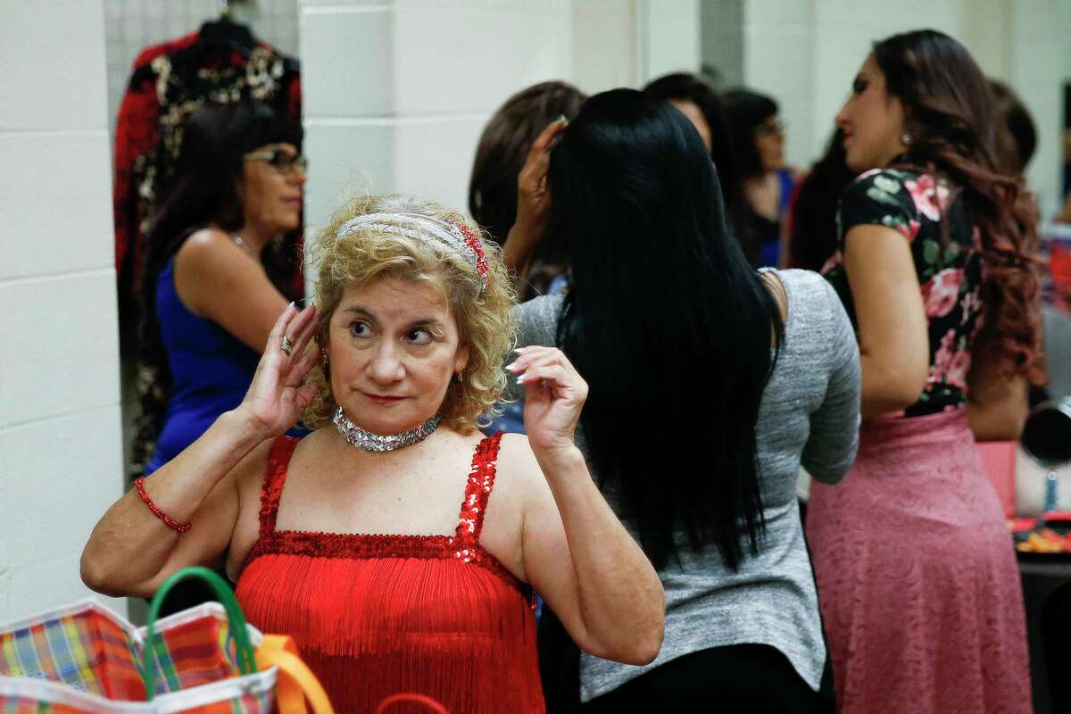 Esperanza Rodriguez, 65, fixes her hair before she competes in the talent portion of the 2017 Ms. Pasadena Senior Pageant Thursday, April 27, 2017 in Pasadena. The winner of the pageant gets a $500 prize, a $2,000 pendant from Frank's & Sons Jewelry and will represent the city at community events for the next year.