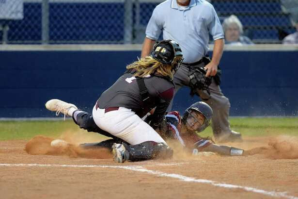 Kat Ibarra (1) of Tompkins scores on sacrifice fly hit by Kendall McGary (4) in the third inning of a bi-district playoff softball game between the Tompkins Falcons and the Kempner Cougars on Friday April 21, 2017 at Tompkins HS, Katy, TX.