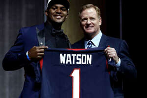 Deshaun Watson joins NFL commissioner Roger Goodell after being selected with the No. 12 pick when the Texans swapped first-round places with the Browns and sent a 2018 first-rounder to Cleveland.