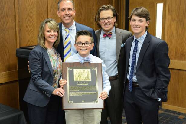 Wayland Board Trustee Robert Kollman and his family were recognized for completing an endowed scholarship that will benefit students in the School of Business. Pictured are Stacey (left), Robert, Deuce (front), Zeke and Eli Kollman.