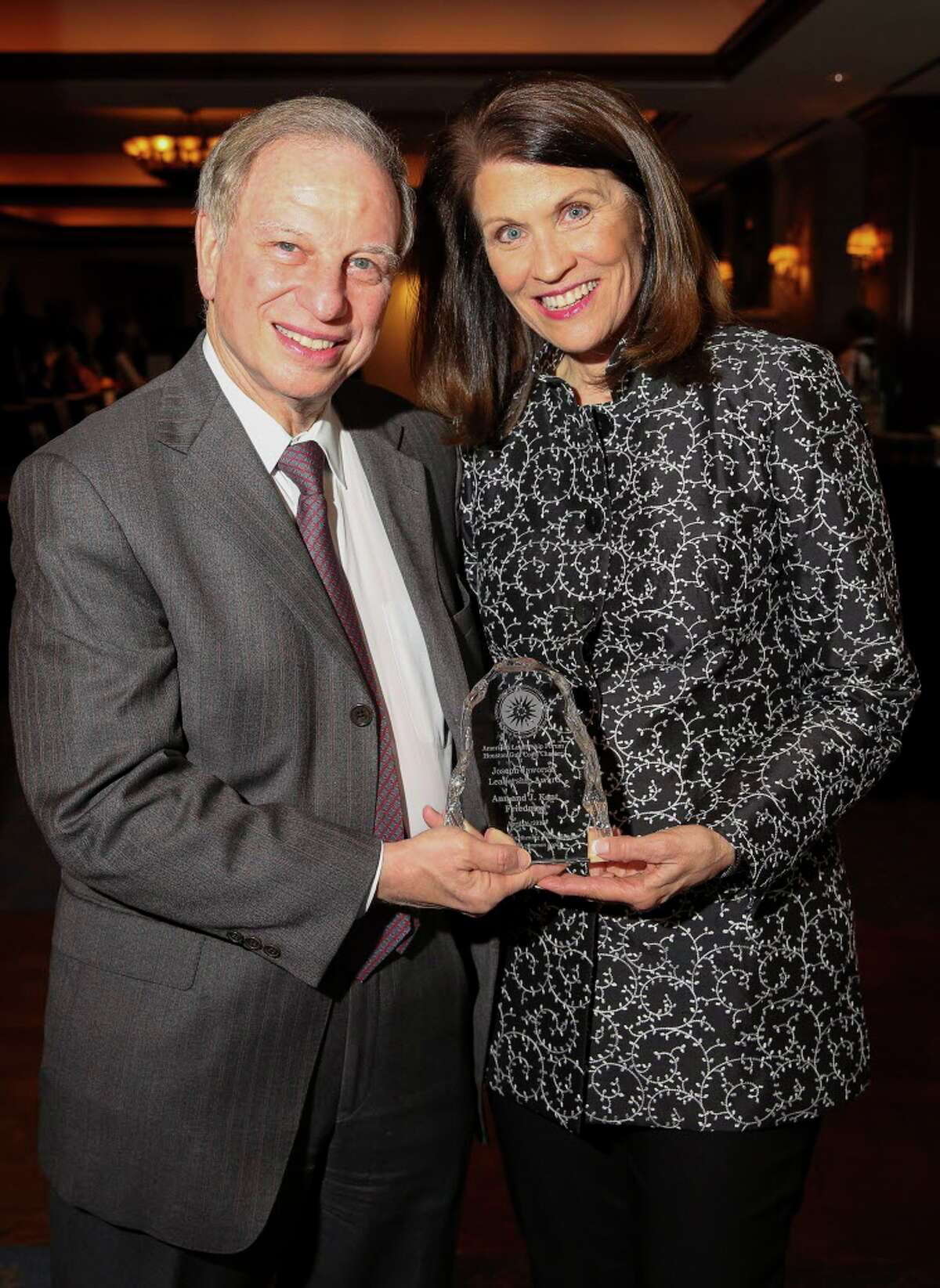 Honorees Ann and J. Kent Friedman pose for a photo with their award award plaque at the American Leadership Forum's Joseph Jaworski Leadership Award dinner at The Houstonian Wednesday, April 26, 2017, in Houston.