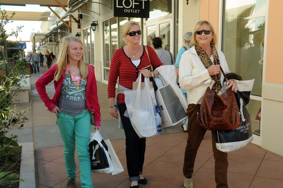 Gracie Williams, 11, from left, a 6th grader at Friendswood Junior High, her mom, Kim, and grandmother, Patty Goolsby, of Dickinson, enjoy some family shopping time at the new Tanger Outlets mall in Texas City. Freelance photo by Jerry Baker Photo: Jerry Baker, Freelance