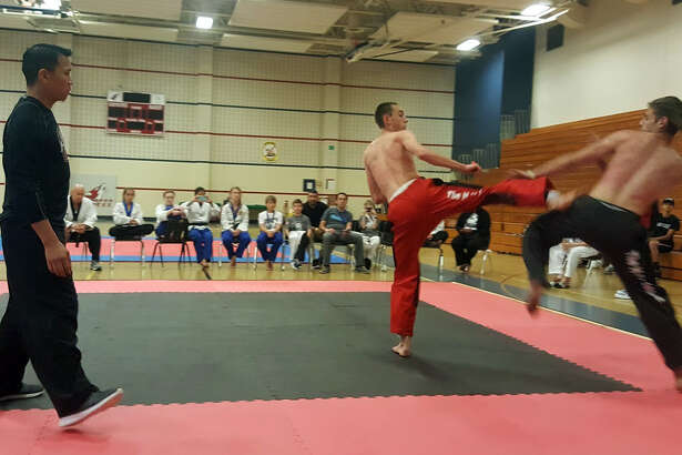 Skye Battenberg and Ryan Spencer demonstrate a HIT League taekwondo fight at LSC-Kingwood Saturday, April 22.