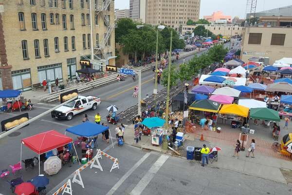 Tents, chairs and vendors line the parade route at 3rd and N. Alamo as thousands of San Antonio residents flock into downtown Friday, April 28, 2017 for the Battle of Flowers Parade.