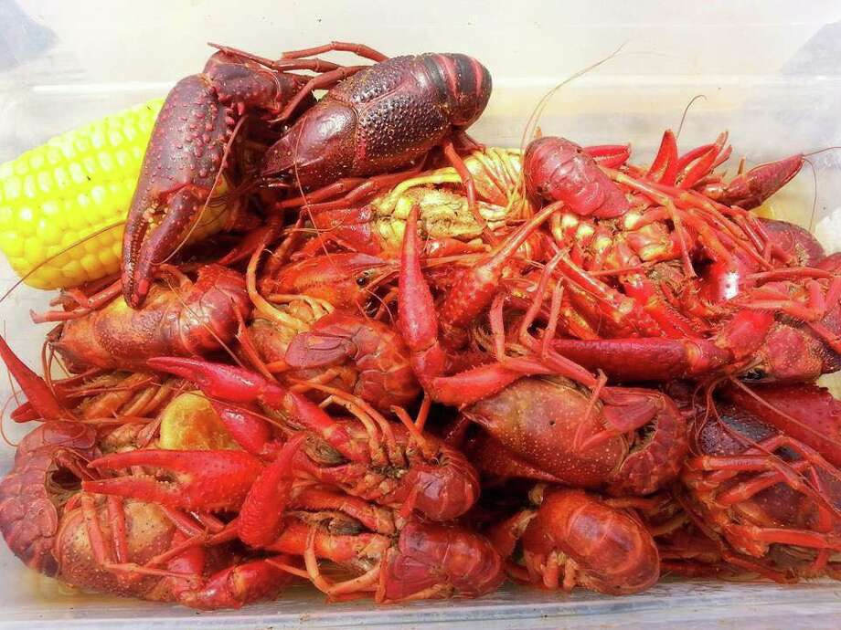 My husband and I tried to prepare ourselves in advance by watching  YouTube videos on how to open them, but they left us more puzzled. You  really have to suck the fat out of the heads? Photo: Red Tailz Crawfish/Facebook
