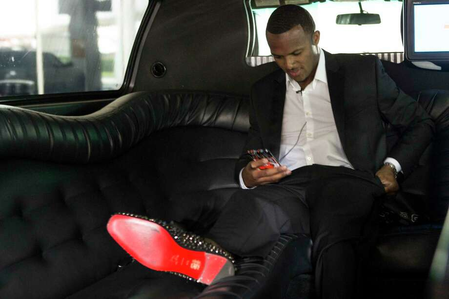 Houston Texans top draft pick Deshaun Watson sits in a limousine upon arriving to George Bush Intercontinental Airport, the day after the Texans made the Clemson quarterback the twelfth overall selection in the NFL Draft, on Friday, April 28, 2017, in Houston. The Texans traded up in the draft with the Cleveland Browns to aquire Watson. Photo: Brett Coomer, Houston Chronicle / © 2017 Houston Chronicle