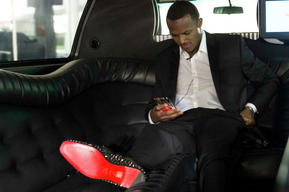 Houston Texans top draft pick Deshaun Watson sits in a limousine upon arriving to George Bush Intercontinental Airport, the day after the Texans made the Clemson quarterback the twelfth overall selection in the NFL Draft, on Friday, April 28, 2017, in Houston. The Texans traded up in the draft with the Cleveland Browns to aquire Watson.