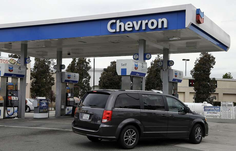 A motorist drives near the pumps at a Chevron gas station in Oakland in April. Photo: Ben Margot, Associated Press