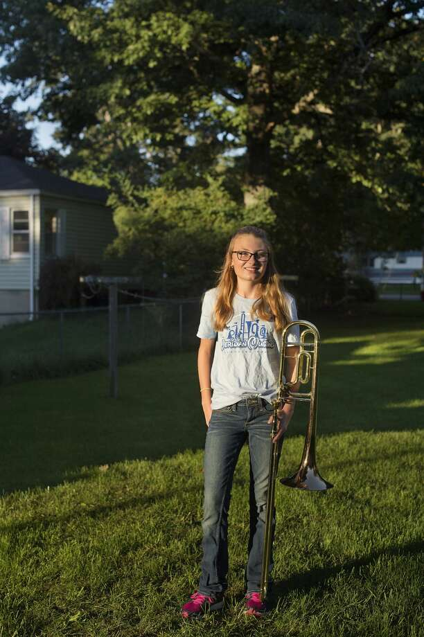 "BRITTNEY LOHMILLER | blohmiller@mdn.net Meridian High School freshman Cassidy Forbes poses for a portrait after practicing her trombone September 2, 2016 in Sanford. ""The band program is what made me want to stay at Meridian,"" Cassidy said. ""We're no know for our sports but our band is good."" Photo: Brittney Lohmiller/Midland Daily News/Brittney Lohmiller"