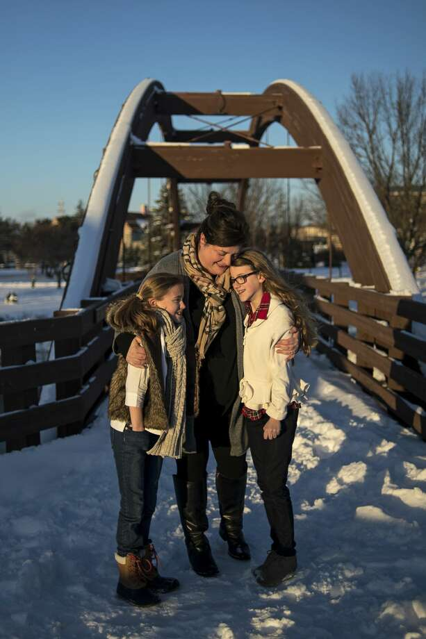 ERIN KIRKLAND | ekirkland@mdn.net Happy.pretty owner Melanie Marshall poses for a portrait on the Tridge with her daughters Chloe Marshall, 11, left, and Annabelle Marshall, 12, right. Photo: Erin Kirkland/Midland Daily News/Erin Kirkland