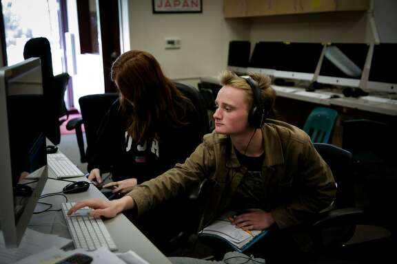 (l-r) Filmmaker Ethan Paisley,16 works on the post-production of a short film in class at Marin School of the Arts at Novato High School in Novato, California, on Tuesday, April 18, 2017.