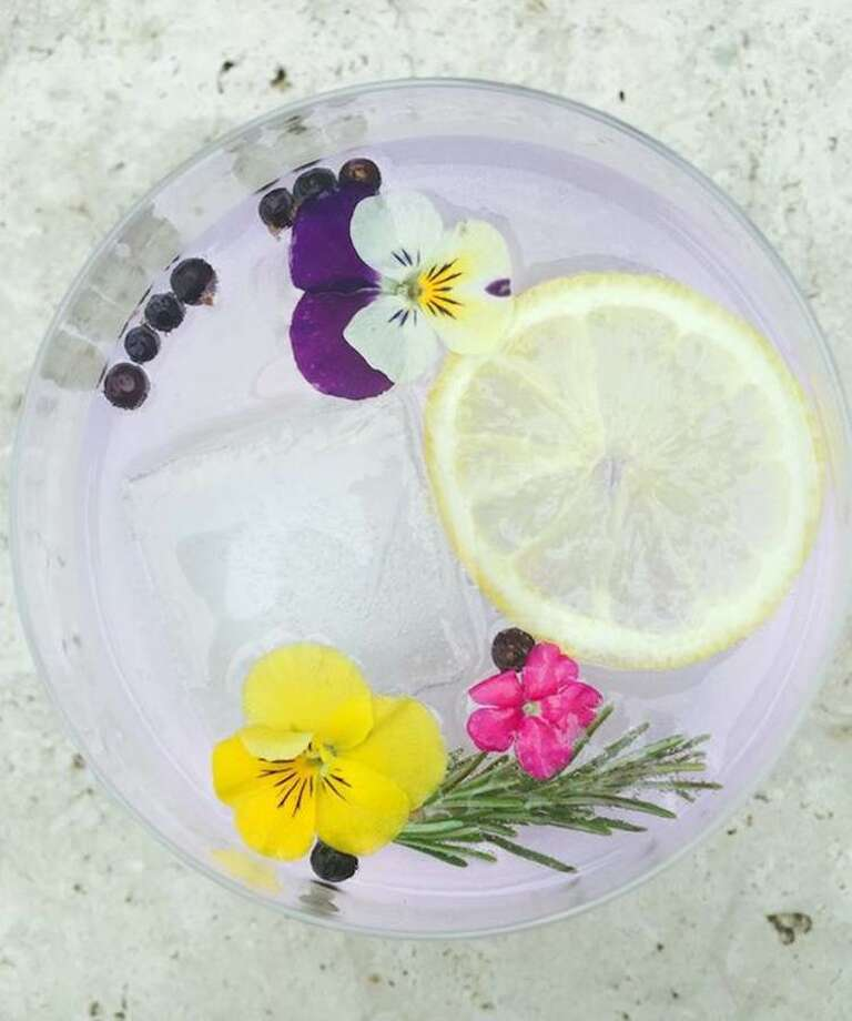 A lavender and gin tonic cocktail.