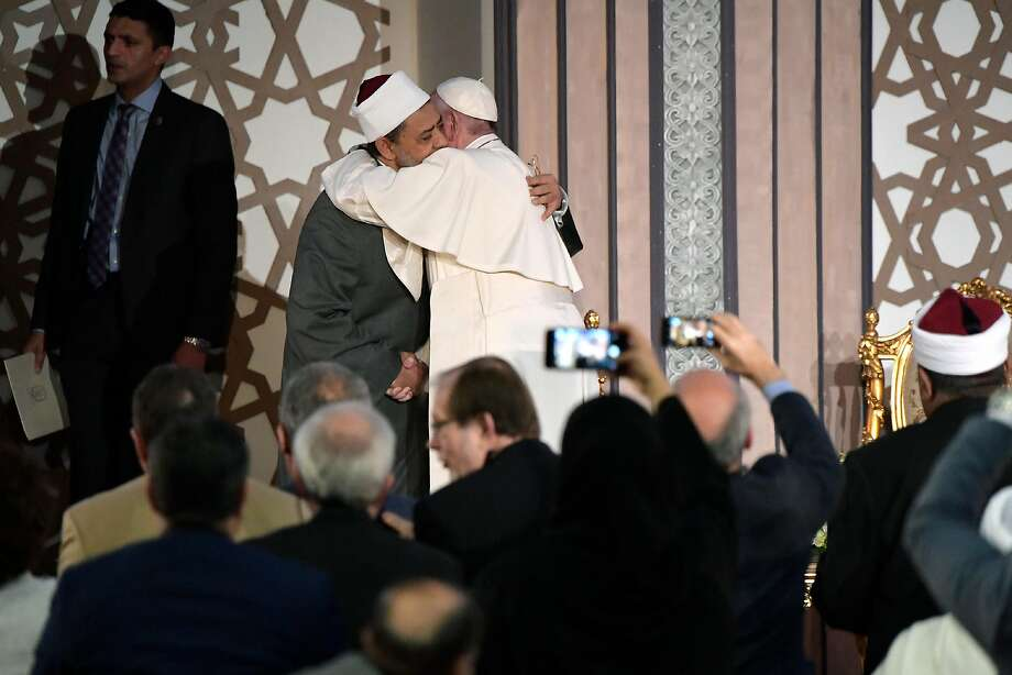 Pope Francis hugs Sheikh Ahmed el-Tayeb at Cairo's Al Azhar university. The pope is in Egypt to promote a united Christian-Muslim front against violence. Photo: Associated Press
