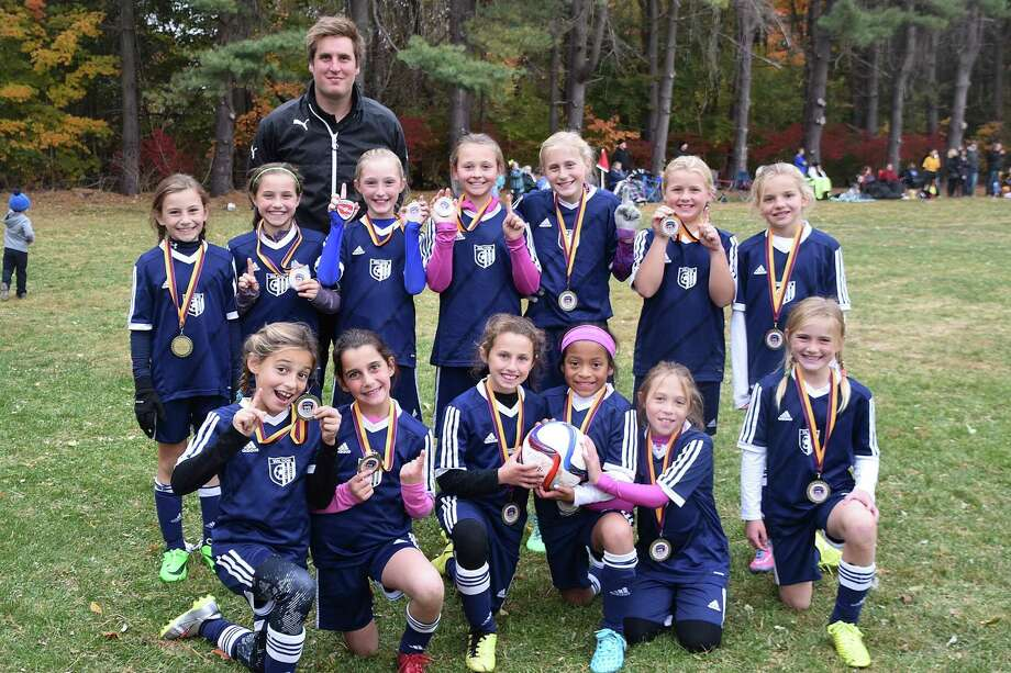 A look back to fall at this Wilton Youth Soccer Girls U-10 Blue soccer team. The spring youth soccer season is under way. Photo: Contributed Photo / Hearst Connecticut Media / Norwalk Hour