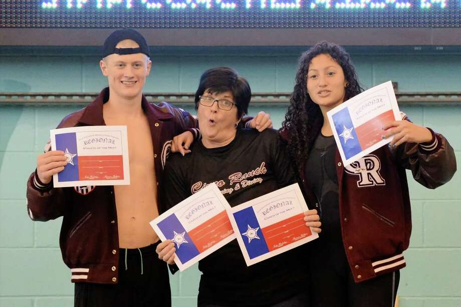 Cinco Ranch swept the Athlete and Coach of the Meet awards at the UIL Conference 5-6A Regional Swimming and Diving finals on February 4, 2017 at the Don Cook Natatorium, Sugar Land, TX.  Shown are Glen Cowand (Left), Aria Bernal (Right) and Coach Christie Patterson (Center) Photo: Craig Moseley, Staff / ©2017 Houston Chronicle