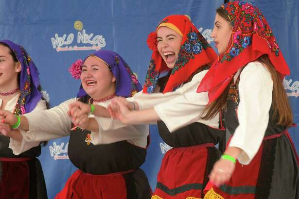 From left: Kefi dancers Eva Beltran, Marina Zafiris and Nicole Graf perform at the Houston Greek Festival at St. Basil the Great Greek Orthodox Church Sunday May 17, 2015.(Dave Rossman photo)