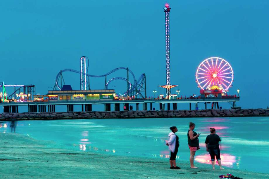 The lights of the Pleasure Pier light up the night sky over the water. Photo: Brett Coomer, Staff / © 2016 Houston Chronicle