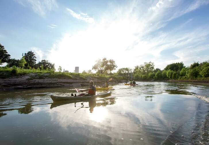 Nick Ellis, from left, and Justin Musgraves kayak on Buffalo Bayou during a photo shoot Friday, April 8, 2016, in Houston.  ( Jon Shapley / Houston Chronicle )