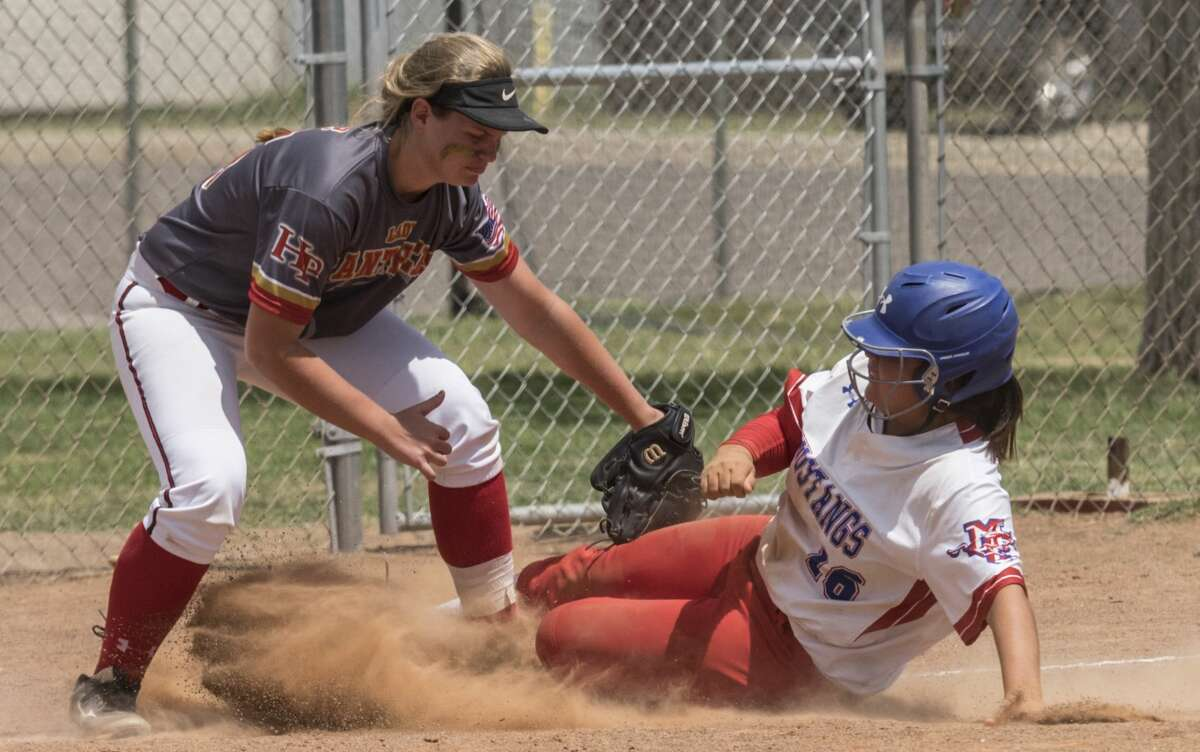 Hyde Park's Savannah Farmer makes the tag at third as Midland Chistian's Clarissa Martinez slides in 4/28/17 during the TAPPS playoff bi-district game at Freddie Ezell Softball Complex. Tim Fischer/Reporter-Telegram