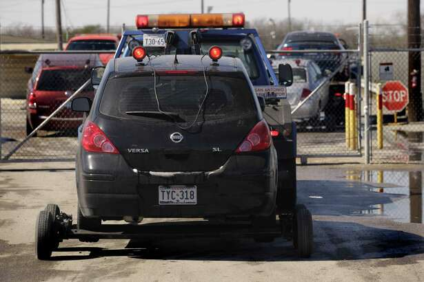 A tow truck waits near the the main gate at the United Road Towing facility in San Antonio in this 2011 photo. The company was sold for about $40 million in a bankruptcy auction earlier this month.