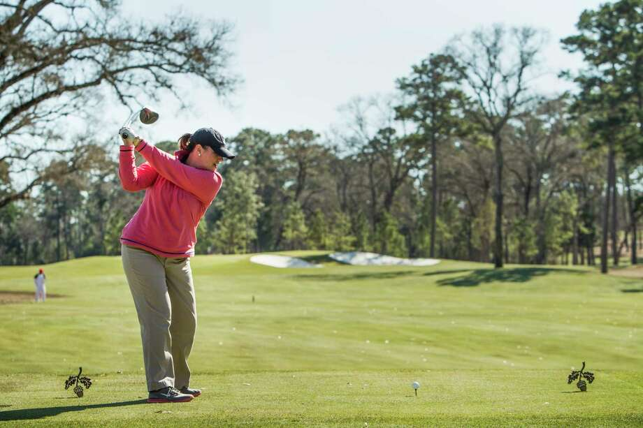 Julie Monzingo tees off at Bluejack National golf course in Montgomery. Bluejack National is a private club and resort-style community located on 755-acres of rolling hills and piney woods in Montgomery.  Bluejack, which features the first Tiger Woods-designed golf course and short course in the United States, is limited to 386 residences and 550 memberships. Photo: Brett Coomer, Staff / © 2016 Houston Chronicle