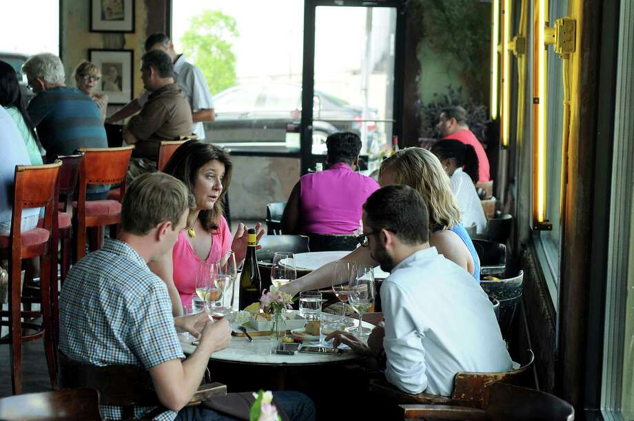 Guests enjoy a glass of wine at 13 Celsius wine bar. Photo: Dave Rossman, Freelance / Freelalnce