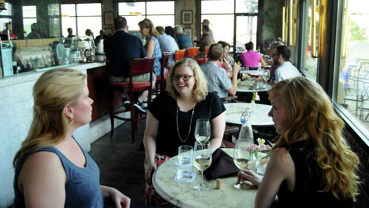 Allison Reeves, Sara Brannon and Alina Slavic enjoy a glass of wine at 13 Celsius wine bar.