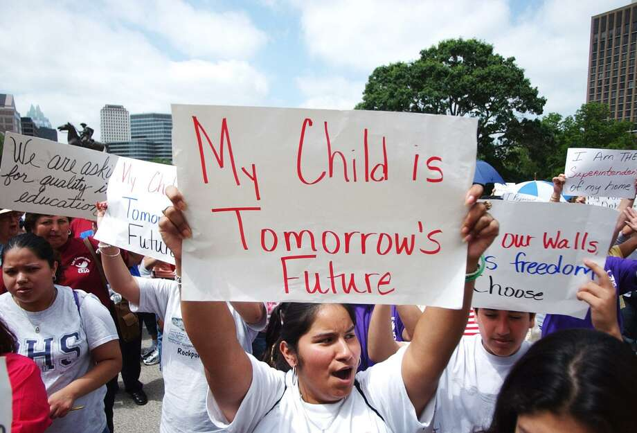 """My child is tomorrow's future""? Given Latino population growth, this sign at a 2004 rally in Austin is even more prophetic now than it was then. The Latino Policy Symposium in San Antonio next week will look at the economic condition of Hispanics and, therefore, the state. Photo: Associated Press File Photo / AUSTIN AMERICAN-STATESMAN"