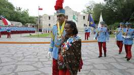 King Antonio XCV Michael Albert Casillas walks with Mayor Ivy Taylor after the 2017 investiture ceremony in Alamo Plaza. Readers continue to weigh in on what has become a controversial plan for the reminagining of the Alamo.