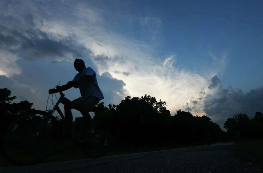 A man rides his bike along the Terry Kershey Hike and Bike Trail at sunset, Tuesday, Sept. 20, in Houston. ( Jon Shapley / Houston Chronicle ) / Houston Chronicle