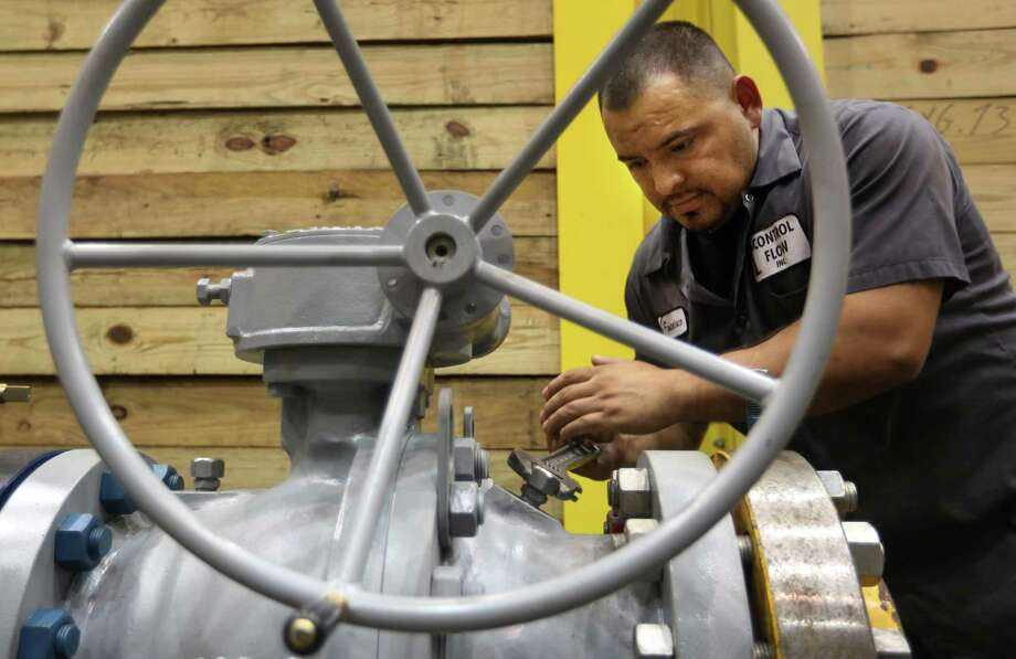 An employee tests an oil well head at Control Flow Inc. in Houston, one of many businesses that was affected in 2015 by a shutdown of the Export-Import Bank. Photo: Houston Chronicle File Photo / © 2015 Houston Chronicle